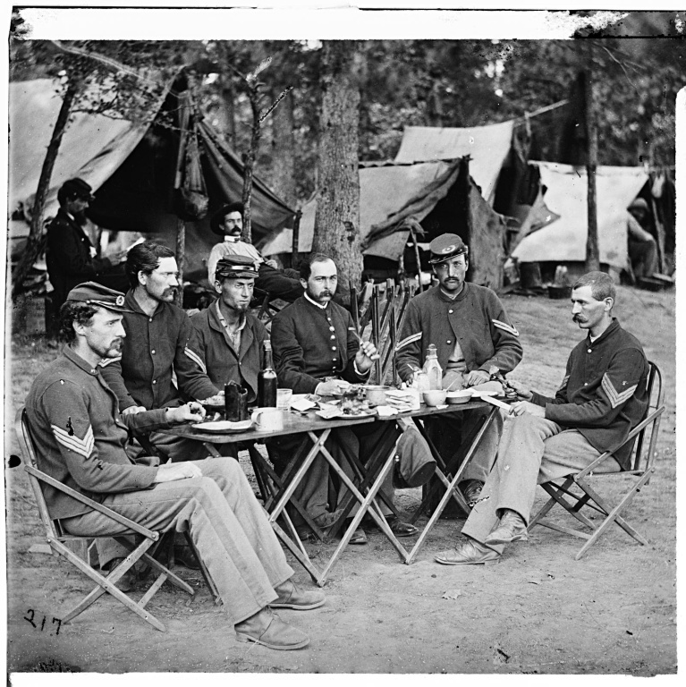 Union soldiers sit around a table circa 1861 unknown location photo